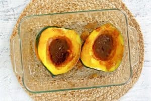 acorn squash with brown sugar butter sauce before being broiled.
