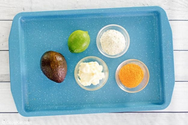 Chick Fil A avocado lime ranch dressing ingredients on a tray.