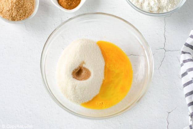 egg, sugar, and vanilla in a bowl.