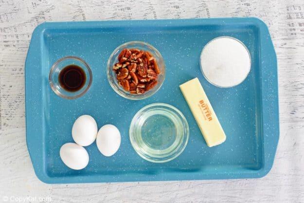 Karo pecan pie ingredients on a tray.