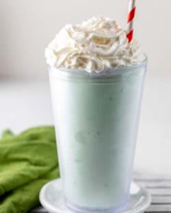 homemade McDonald's Shamrock Shake and a green kitchen towel.