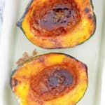 overhead view of microwave acorn squash with brown sugar butter sauce.