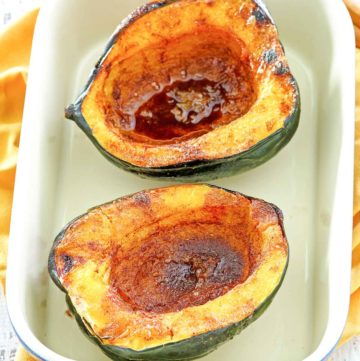 microwave acorn squash in a serving dish.