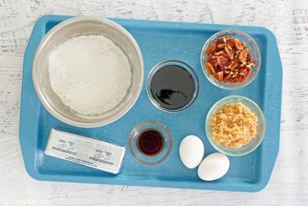 pecan pie brownies ingredients on a tray.