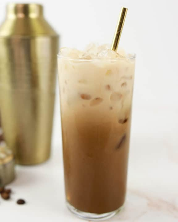 homemade Starbucks iced brown sugar oatmilk shaken espresso coffee drink in a glass.